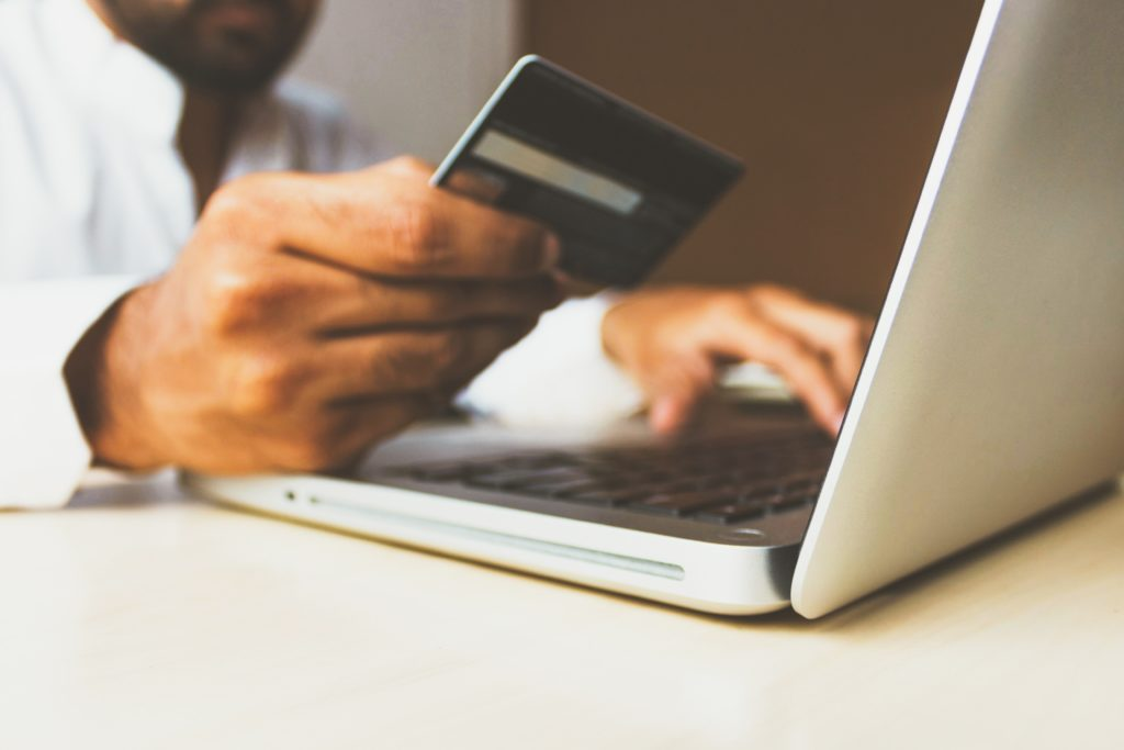 Man sitting at laptop with credit card