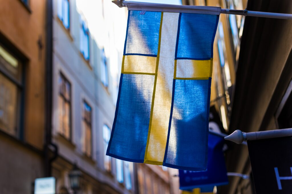 Swedish flag hanging outside a building