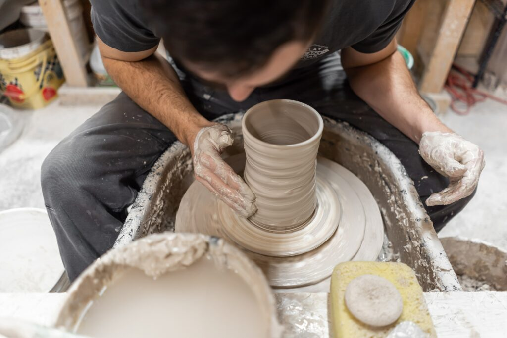 Man using pottery wheel